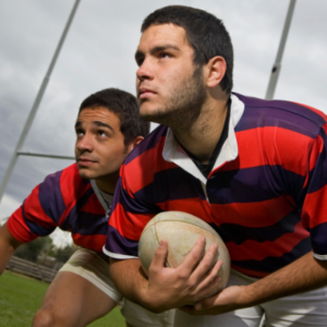 Two rugby players with rugby ball